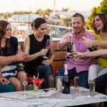 Friends having fun at a bar — Stock Photo #34986225
