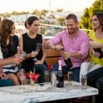Friends having fun at a bar — Stock Photo #34986233