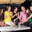 Friends having fun at a bar — Stock Photo