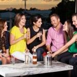 Friends having fun at a bar — Stock Photo #34986383