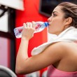 Athlete drinking water after a workout — Stock Photo