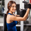 Girl shakes muscle simulator — Stock Photo #37045483