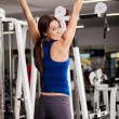 Girl pulls on the bar — Stock Photo