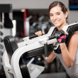 Girl shakes muscle simulator — Stock Photo #37045559