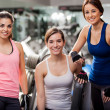 Portrait of three girls in the gym — Stock Photo