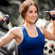 Stock Photo: Girl training with dumbbells