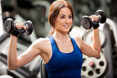 Girl training with dumbbells — Stok fotoğraf