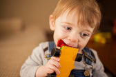 Baby playing with toy car — Stock Photo