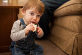 Baby boy eating bread — Stock Photo