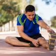 Young athlete stretching — Stock Photo