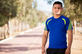 Latin man in a running track — Stock Photo