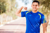 Happy guy showing off his strength — Stock Photo