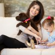 Mother and daughter with dog and tablet — Stock Photo