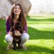 Stock Photo: Girl with dog outdoors