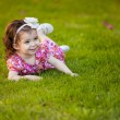Girl lying on the grass — Stock Photo #40135553