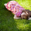 Girl lying on the grass — Stock Photo