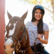 Woman taking a ride with her horse — Stock Photo