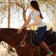 Woman riding a horse on a sunny day — Stock Photo