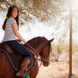 Young woman riding a horse — Stock Photo
