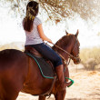 Woman riding a horse and looking forward — Stock Photo