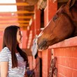 Girl enjoying the company of her horse — Stock Photo