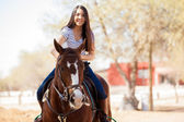 Woman enjoying a horse ride — Stock Photo