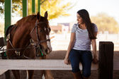 Girl with her horse at a ranch — Stock Photo