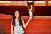 Woman hanging out with her horse — Stock Photo