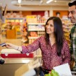 Young couple using a credit card at the store — Stock Photo