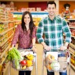 Happy couple shopping together — Stock Photo #42682167