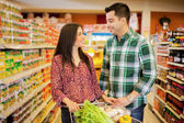 Young couple looking to each other at the store — Stock Photo
