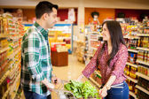 Happy couple flirting at the store — Stock Photo