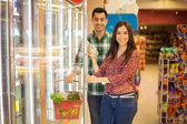 Happy couple buying healthy food at a store — Foto de Stock