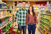 Happy couple buying some groceries — Stock Photo