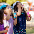 ������, ������: Little girls trying to make more bubbles than their friends