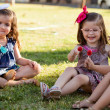 Cute Latin little friends eating some lollipops together on a day of summer — Stock Photo #43226545