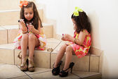 Little sisters stealing some makeup — Stockfoto