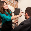Lady barber cutting hair — Stock Photo