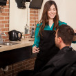 Cutting hair at a barber shop — Stock Photo