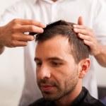 Hispanic man getting a haircut — Stock Photo