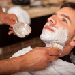Getting shaved in a barber shop — Stock Photo #45099187