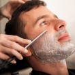 Closeup of a man getting shaved — Stock Photo #45099289