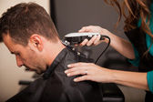 Getting haircut at a salon — Stock Photo