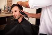 Trimming hair in a barber shop — Stock Photo