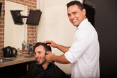 Happy barber enjoying work — Stock Photo