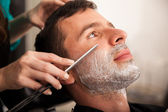 Closeup of a man getting shaved — Stock Photo