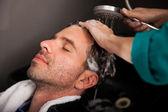 Washing hair in a salon — Stock Photo