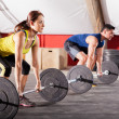 Lifting weights at a gym — Stock Photo #46794575