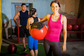 Happy girl with medicine ball — Stock Photo