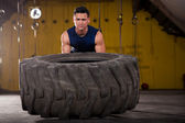 Exercising with a big tire — Stock Photo